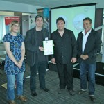 A photo of the Igam Ogam team recieving certificate
