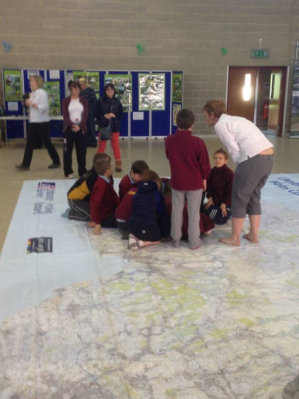 School children exploring giant map of wales
