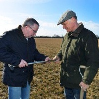 Richard Page out in the field testing his soil